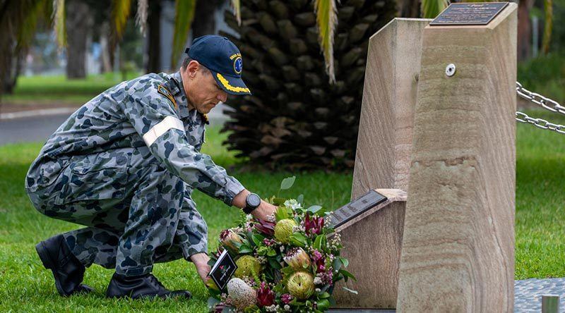 Executive Officer HMAS Albatross Commander Nigel Rowan lays a wreath to remember those lost in the 2005 Sea King helicopter crash at the Shark 02 memorial at HMAS Albatross. Photo by Chief Petty Officer Cameron Martin.