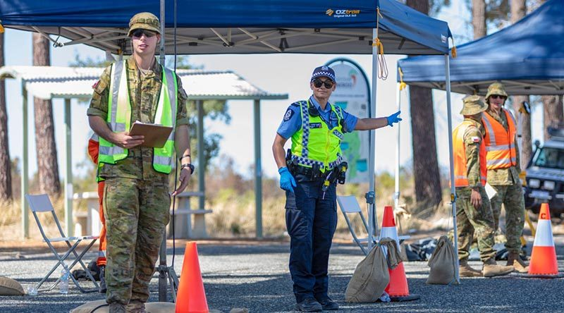 Private Connor Place-Diamond from 16th Battalion, Royal Western Australia Regiment, assists Western Australian Police Officer First Class Constable Linda Taurima to conduct a traffic stop on Indian Ocean Drive in Wilbinga as part of the Defence Assistance to the Civil Community support for COVID-19 Assist. Photo by Leading Seaman Ernesto Sanchez.