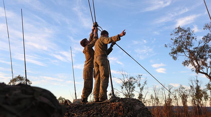 Soldier from 1RAR set up comms at High Range Training Area. Photo by Brian Hartigan.