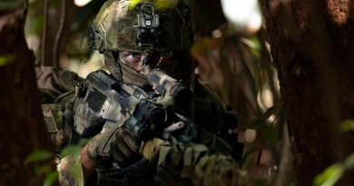 A sniper from the 2nd Battalion, Royal Australian Regiment, patrols through the Cowley Beach Training Area, north Queensland. Photo by Corporal Tristan Kennedy.