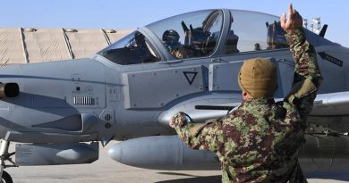 An Afghan Air Force A-29 Super Tucano crew chief give signals to his pilot before takeoff at Kandahar Airfield, Afghanistan. The AAF has an approved strength of about 8000 aircrew, maintainers and support staff. AAF is based at three air wings and multiple detachments across Afghanistan. US Air Force photo by Staff Sergeant Sean Martin.