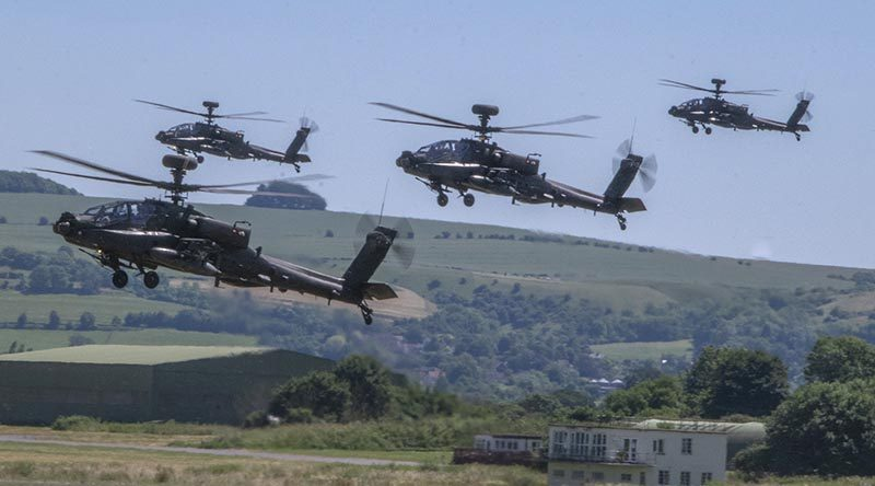 Four British Army Apache attack helicopters operated from Wattisham Flying Station in Suffolk. Photo by Richie Willis, copyright British Ministry of Defence.