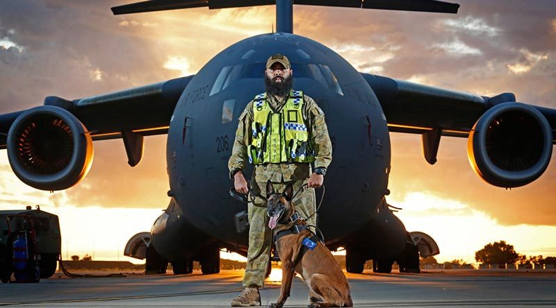 Military working-dog handler Corporal Brodie McIntyre with his dog Kesha provides security to an Air Force C-17A Globemaster at RAAF Base Darwin. Photo by Sergeant Ben Dempster.