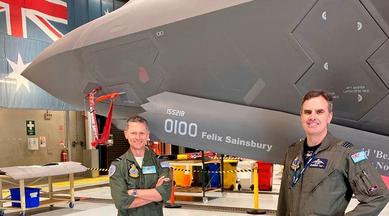 Commander Air Combat Group Air Commodore Tim Alsop and Commanding Officer No. 3 Squadron Wing Commander Darren Clare show off the front of Joint Strike Fighter A35-010, temporarily rebranded in celebration of Felix Sainsbury's 100th birthday.