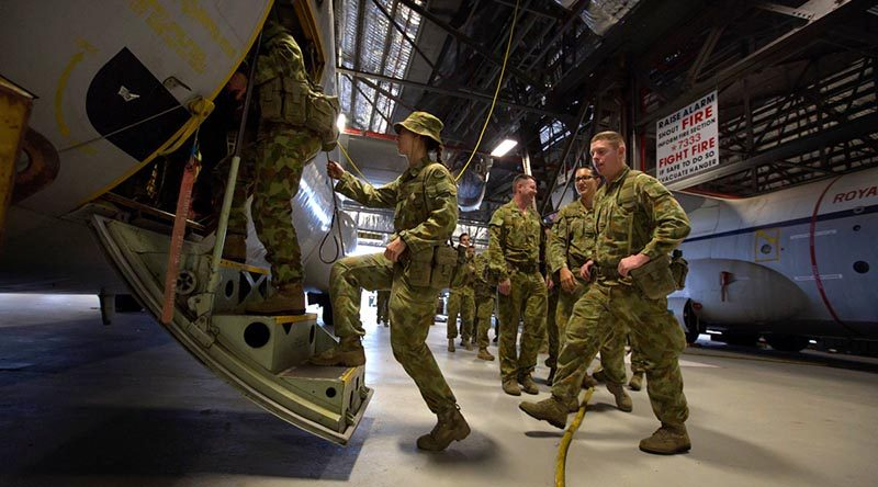Personnel from 176 Air Dispatch Squadron board a C-130 Hercules training aid at RAAF Base Richmond. Photo by Corporal Oliver Carter.