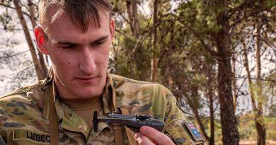 Lance Corporal Ash-Leigh Liebeck, 7RAR, inspects a Black Hornet nano UAV. Photo by Private Luke Jones.