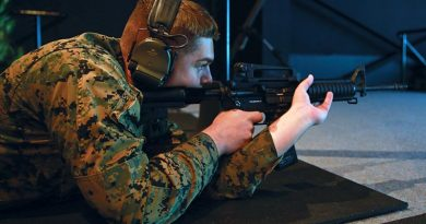 US Marine Corps Corporal Isaiah Fraser, with Marine Rotational Force – Darwin, shoots an M4 carbine at Robertson Barracks, Darwin after the Marine service rifle was integrated with the Australian's Weapons Training Simulation System for the first time. US Marine Corps photo by Lance Corporal Natalie Greenwood.