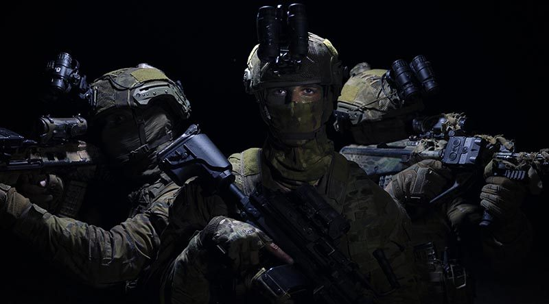 Private Kai Cooper (centre) from the 2nd Battalion, Royal Australian Regiment, during amphibious raid training at the Cowley Beach Training Area, north Queensland. Photo by Sergeant Jake Sims.