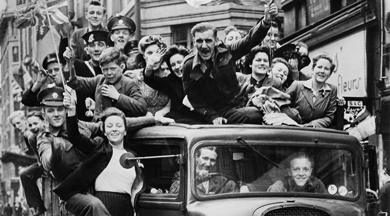Ve Day Celebrations in London, 8 May 1945 A truck of revellers passing through the Strand, London. Imperial War Museum collection.