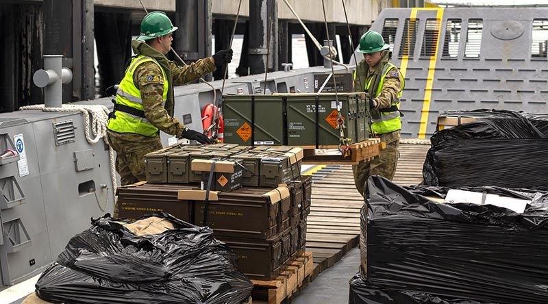 Australian Army Cargo Specialists and Thales personnel move pallets of ammunition from an HMAS Adelaide landing craft to the wharf at Eden, NSW. Photo by Able Seaman Jarrod Mulvihill.