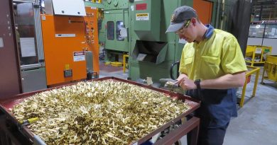 Patrick Warner of Thales Australia examines cartridge cases for 5.56mm ammunition during the manufacturing process at Benalla, Victoria.
