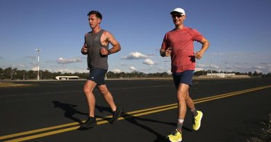 Pilots Flight Lieutenant Tom, right, and support crew member Flight Lieutenant Sam, from No. 1 Squadron, maintain the pace during the 24-hour charity running challenge at RAAF Base Amberley. Photo by Corporal Colin Dadd.