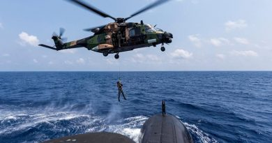 A Royal Australian Navy sailor is lowered to the casing of HMAS Collins from an MRH-90 helicopter in the Bay of Bengal during AUSINDEX 2019. Photo by Leading Seaman Jake Badior.
