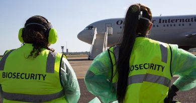 The first plane-load of Marine Rotational Force-Darwin marines are greeted by biosecurity officers at RAAF Base Darwin. The marines were tested for COVID-19 and placed in a 14-day quarantine facility. US Marine Corps photo by Lance Corporal Natalie Greenwood.