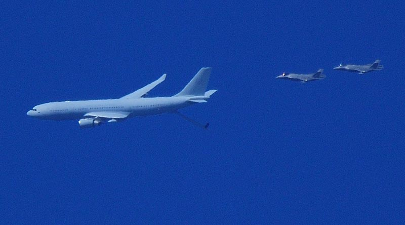 A pair of F-35A Lightning II fighter aircraft from RAAF Base Williamtown marry up with an KC-30A multi-role tanker transport over Taree NSW. Photo by Bill Mastrippolito from Facebook.