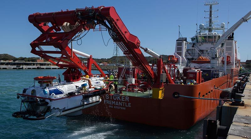 The submarine rescue vessel LR5 is recovered on to the work deck of MV Stoker from the basin at Fleet Base - West after a systems test run during Ex Black Carillon 2016. Photo by Leading Seaman Bradley Darvill.