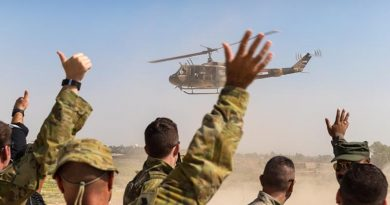 Australian soldiers and Iraqi forward air controllers wave to the crew of an Iraqi Army helicopter as it departs at the conclusion of training at Taji Military Complex, Iraq. Photo by Corporal David Said.