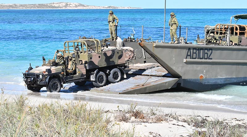 The first RSFG vehicle comes ashore at Norwegian Bay. Australian Border Force photo.