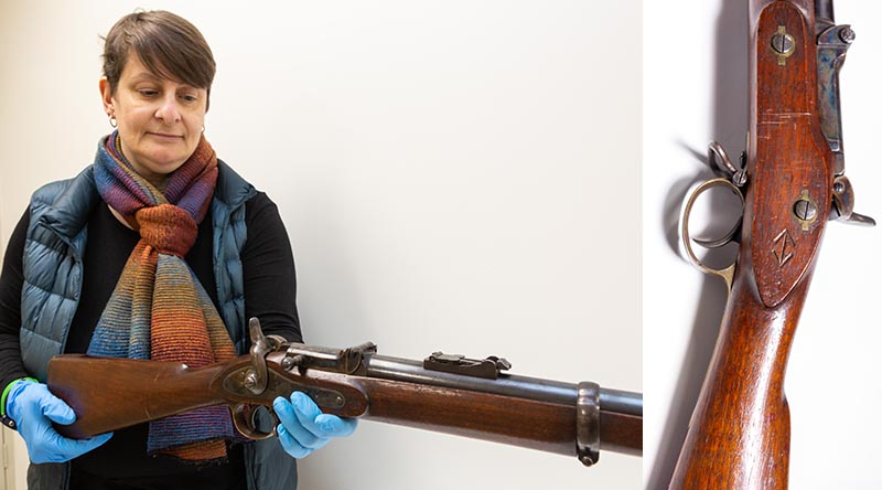 Corinne Ball, Curator History Trust of South Australia, inspects the 1868 Braendlin-Albini rifle. Photo by Leading Aircraftwoman Jacqueline Forrester.