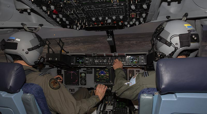 No. 36 Squadron pilots Flight Lieutenants Tim Smith, left, and Matthew Bruton fly a mission in the C-17A Globemaster III simulator during Exercise Virtual Pitch Black at RAAF Base Amberley. Photo by Sergeant Peter Borys.