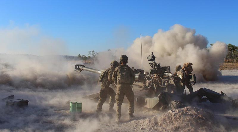 Members of the 101st Battery direct fire an M777 lightweight towed howitzer during Exercise Ready Hammer at Mount Bundey Training Area, Northern Territory. Photo by Gunner Adel Hejji.