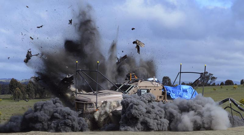 A Hawkei is subjected to a live-fire underbelly blast testing during trials in 2011.