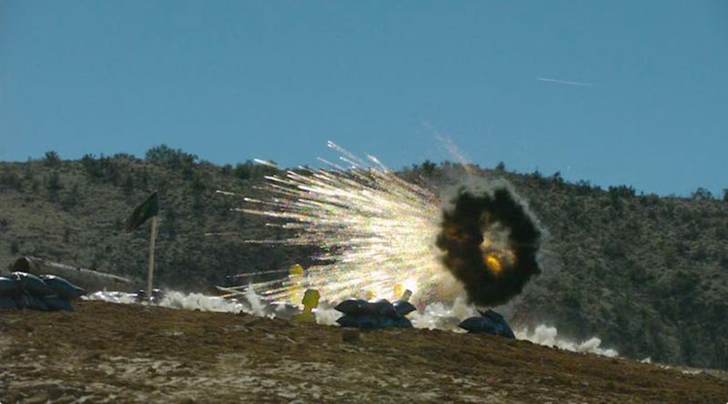 A 30mm airburst cartridge fired from a 30mm Bushmaster chain gun during a test, showcases the system's ability to defeat man-type targets in defilade positions. Photo supplied by Northrop Grumman.