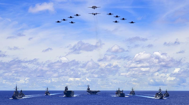 HMA Ships Canberra, Hobart, Stuart, Arunta and Sirius taking part in a trilateral passage in the Philippine Sea with US Navy ships Ronald Reagan, Antietam and Mustin and the Japanese Maritime Self-Defense Force's JS Teruzuki.