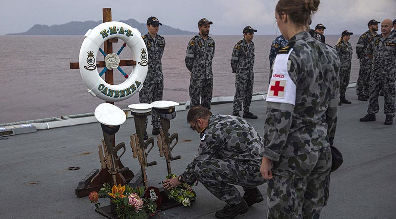 Commanding Officer HMAS Canberra Captain Terry Morrison lays a wreath to commemorate the sinking of HMAS Canberra I off Savo Island, Solomon Islands. Photo by Leading Seaman Ryan Tascas.