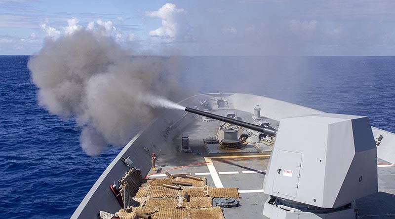 HMAS Hobart fires its 5-inch gun during Exercise RIMPAC 20. Photo by Leading Seaman Ernesto Sanchez.
