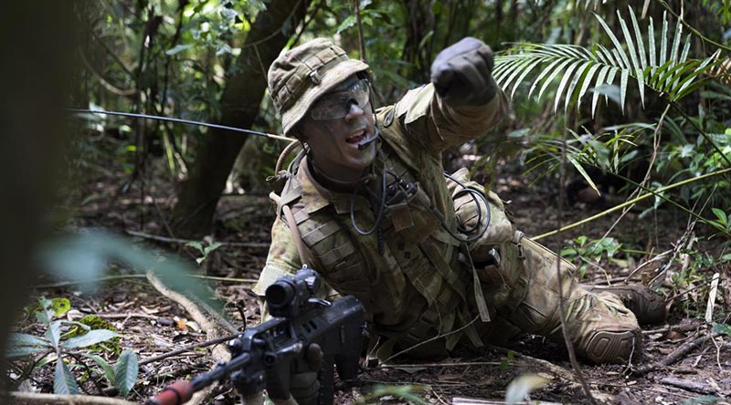 Lieutenant Patrick Omodei, of 3rd Battalion, Royal Australian Regiment, calls out enemy target indications during the Infantry Regimental Officers Basic Course. Photo by Corporal Brodie Cross.