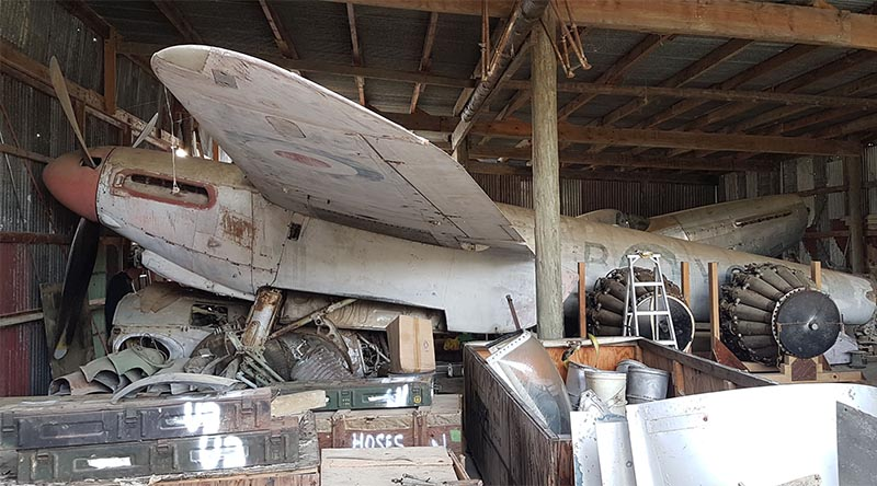 A de Havilland Mosquito and tonnes of aircraft parts and memorabilia in the 'Aladin's Cave' shed of recluse Kiwi collector John Smith. Photo by Graham Orphan.