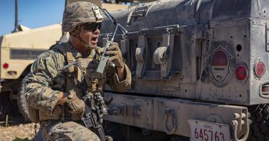 US Marine Corps Sergeant Jacob Montana with Combined Anti-Armor Team, Ground Combat Element, Marine Rotational Force – Darwin, relays commands to his Marines during a simulated fire mission at Mount Bundey Training Area, NT. US Marine Corps photo by Corporal Lydia Gordon.