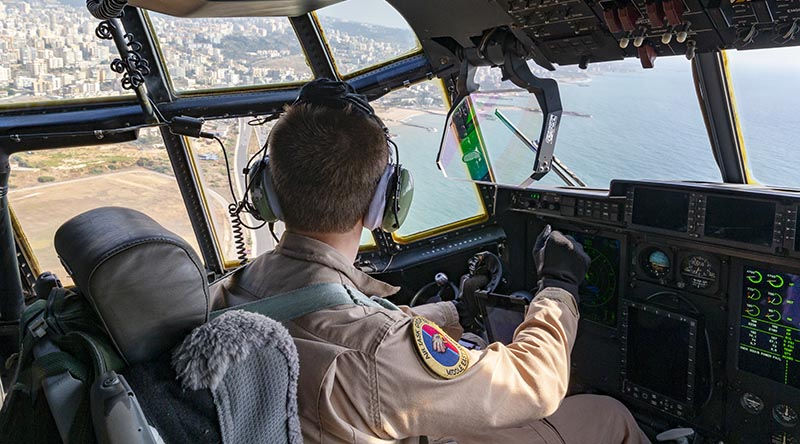 A Royal Australian Air Force pilot look over Beirut from the flight deck of his C-130J Hercules loaded with Australian aid relief supplies for the people of Lebanon. Photo by Corporal Tristan Kennedy.