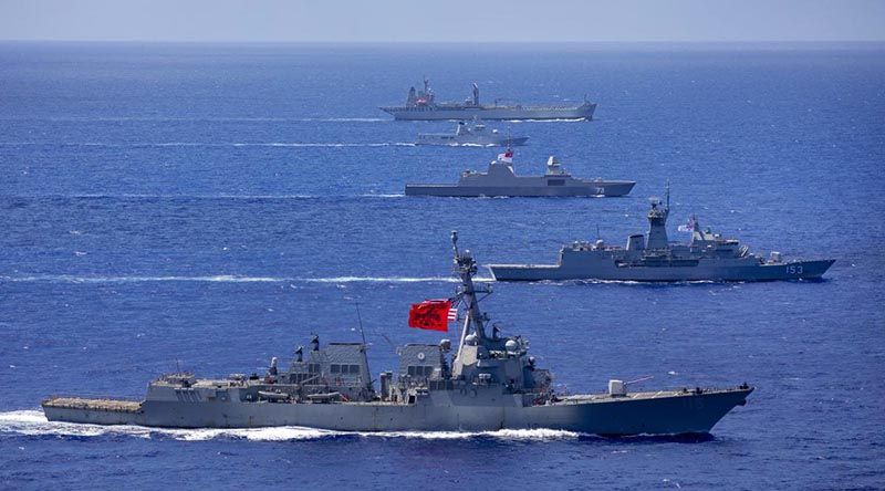 HMA Ships Sirius (top) and Stuart (second from bottom) sail in company with RSS Supreme, KDB Daruleshan and USS Rafael Peralta through the Pacific Ocean. Photo by Leading Seaman Christopher Szumlanski.