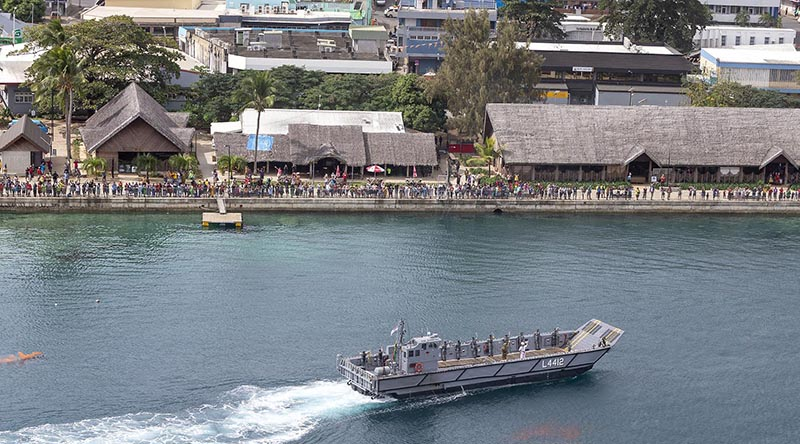 A landing craft from HMAS Choules prepares to join the Vanuatu Police Maritime Wing in a Seafarer's Parade to celebrate VanuatuIndependenceDay. Photo by Leading Seaman James McDougall.