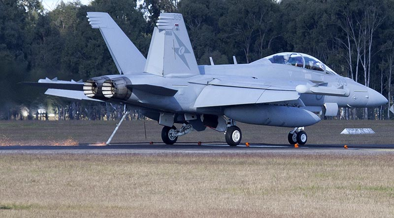 A RAAF E/A-18G Growler from No 6 Squadron takes the arrestor cable at RAAF Base Amberley during Exercise alisman Saber 17. Photo by Sergeant Peter Borys.