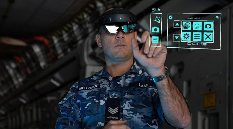 Sergeant Thomas Lane from No. 36 Squadron uses the HoloLens mixed-reality device during maintenance of a C-17A Globemaster III aircraft.