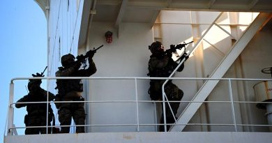 Special Air Service Regiment soldiers prepare to secure a ship's bridge during martime counter-terrorism training. Photo by Corporal Christopher Dickson.