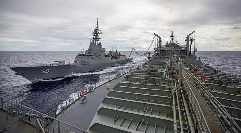HMAS Sirius conducts her 700th replenishment at sea, with HMAS Hobart, during their Regional Presence Deployment. Photo by Leading Seaman Christopher Szumlanski.