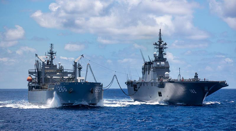 HMAS Sirius conducts a replenishment at sea with Japanese Ship Ise in the southern waters of Hawaii during Exercise RIMPAC. Photo by Leading Seaman Christopher Szumlanski.