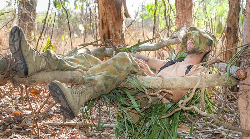 Corporal Mark Rudledge sleeps through mid-day heat during the survival phase of Exercise Kowari 2015, in the Daly River region, NT. Photo by Corporal Kyle Genner.
