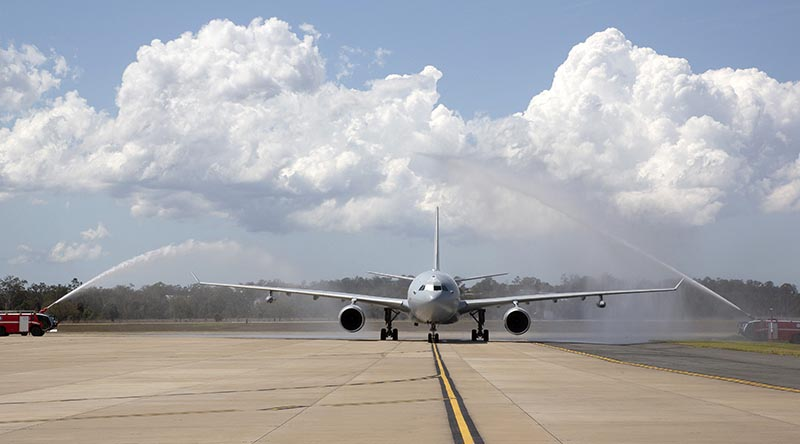 KC-30A Multi Role Tanker Transport A39-006 transporting No. 33 Squadron personnel returning home from the Middle East, is given a guard of honour by No. 23 Squadron Fire Section on arrival at RAAF Base Amberley. Photo by Corporal Colin Dadd.