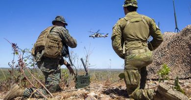 US Marine Corps Captain Benjamin Hovies and Australian Army Sergeant Aaron Costas manage airspace at Mount Bundey Training Area, during a US Air Force bombing mission. US Marine Corps photo by Corporal Harrison Rakhshani.