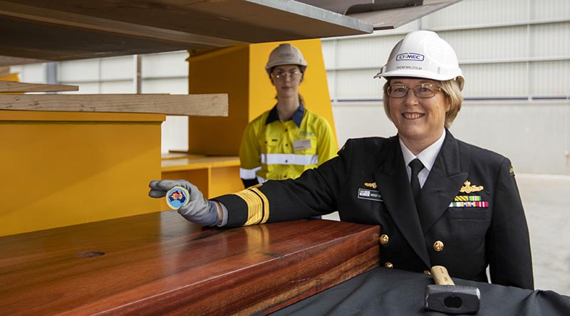 Head of Maritime Systems Rear Admiral Wendy Malcolm displays the Chief of Navy's ceremonial coin about to be placed under the keel NUSHIP Pilbara at the Civmec facility in Henderson, Western Australia. Photo by Leading Seaman Ronnie Baltoft.