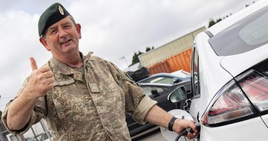 Trentham Camp Commander Major Jim Maguire plugs into the new charging station on camp. NZDF photo.