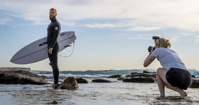 Royal Australian Air Force imagery-specialist trainee Aircraftwoman Emma Schwenke captures a portrait of Royal Australian Navy Leading Seaman Michael Douglas from HMAS Canberra, at Maroubra Beach. Photo by Sergeant Christopher Dickson.