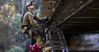 Lieutenant James Bonney attaches simulated explosives to a bridge during the final field phase of the Engineer Regimental Officer Basic Course. Photo by Sergeant Ray Vance.