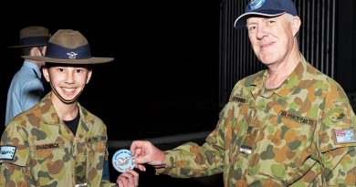 CCPL Jack Shadwick receives his first powered solo flight commemorative patch from the Executive Officer of No 704 Squadron, FLGOFF(AAFC) James Firkins, himself a qualified pilot and instructor.