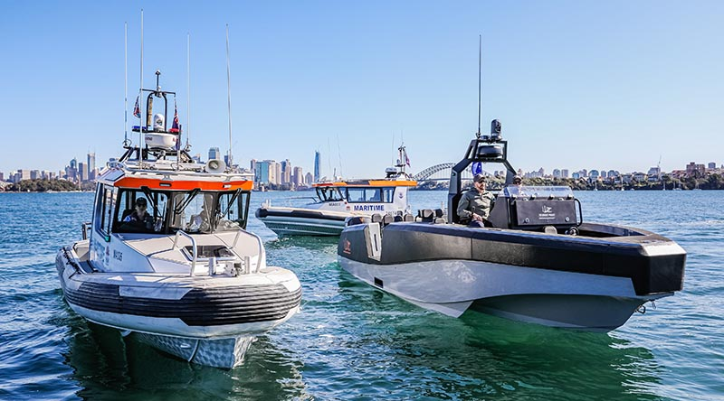 A Whiskey Alpha 85 (right) and two Marine NSW boats designed by Naiads and built by YWE. Photo © Salty Dingo 2020.